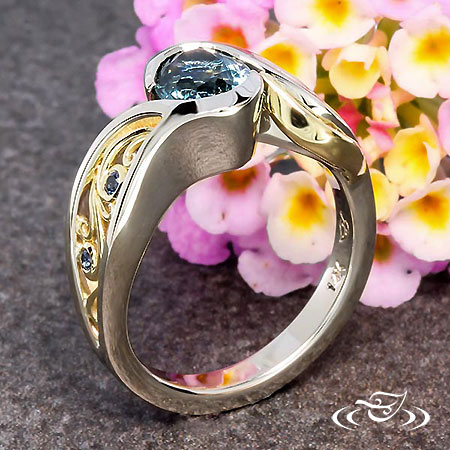 WATERFALL INSPIRED WRAP RING HOLDING A OVAL MONTANA SAPPHIRE