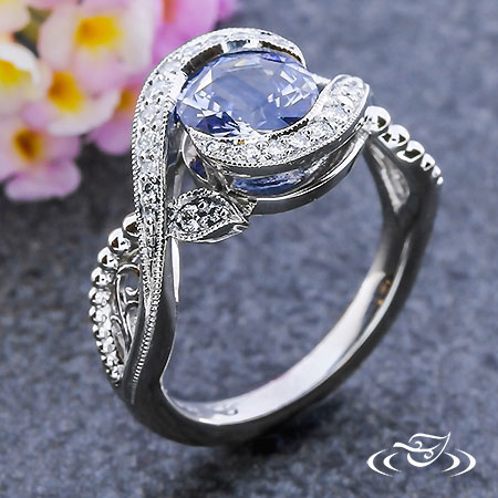 BLUE SAPPHIRE AND DIAMOND WRAP ENGAGEMENT RING