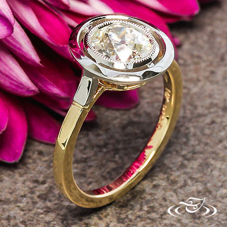 PLATINUM HALO AND YELLOW GOLD ENGAGEMENT RING