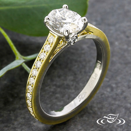 OVAL GOLD AND PLATINUM ENGAGEMENT RING