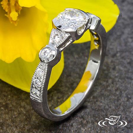 DIAMOND HALF BEZEL ENGAGEMENT RING