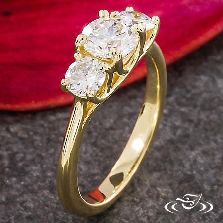 CLASSIC YELLOW GOLD THREE STONE ENGAGEMENT RING