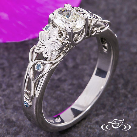FLORAL ENGAGEMENT RING WITH BLUE DIAMONDS