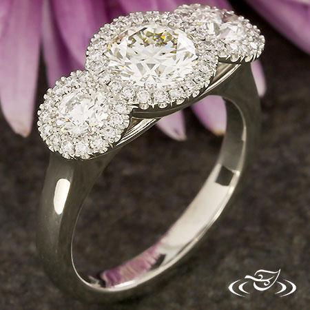 PLATINUM THREE STONE HALO ENGAGMENT RING