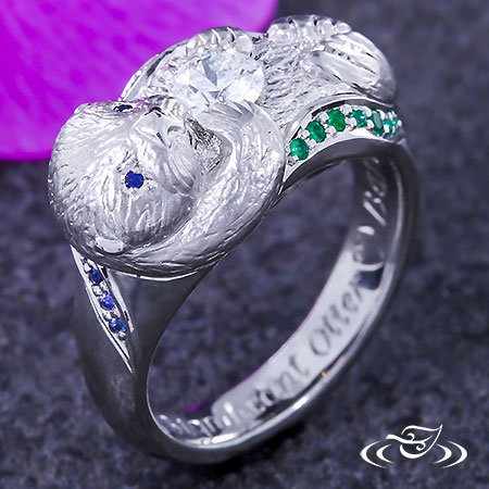 CARVED OTTER RING WITH EMERALD AND SAPPHIRE WAVES