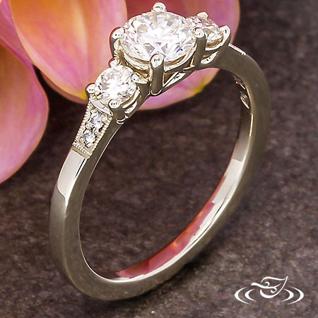 CLASSIC THREE STONE RING WITH DIAMOND ACCENTS