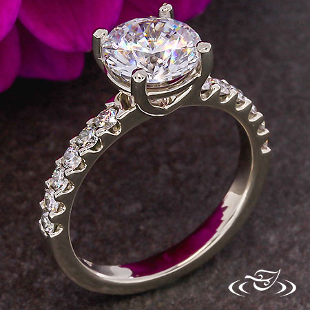 CLASSIC 4 PRONG SOLITAIRE WITH DIAMOND FISHTAIL ACCENTS