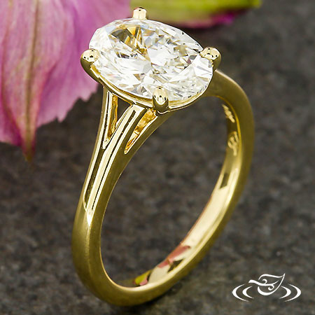 GOLDEN OVAL ENGAGEMENT RING