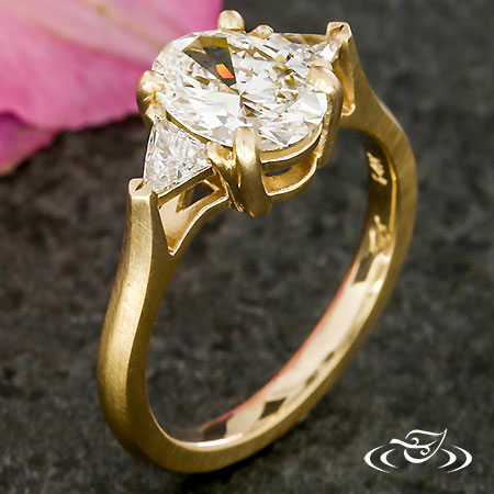 OVAL AND TRILLION THREE STONE RING