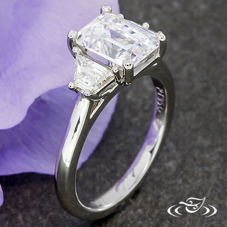 CLASSIC EMERALD CUT THREE STONE