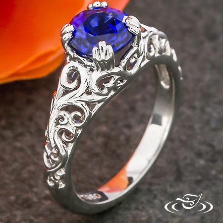 ROYAL BLUE SAPPHIRE & PIERCED CURL ENGAGEMENT RING