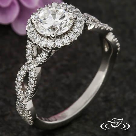 TWISTING DIAMOND HALO ENGAGEMENT RING