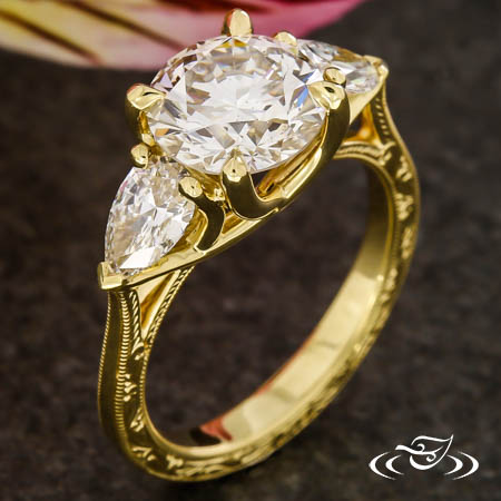 ENGRAVED YELLOW GOLD THREE STONE ENGAGEMENT RING
