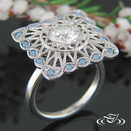 PLATINUM ANTIQUE STYLE PIERCED DIAMOND AND OPAL SQUARE HALO RING