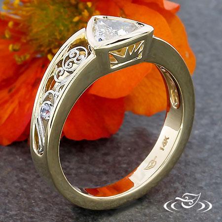 TRISKELION TRILLION DIAMOND ENGAGEMENT RING.